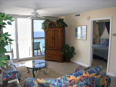 View to Master bedroom - king bed, private bathroom, and access to the balcony.