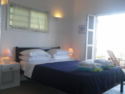 Ensuite room with Queen bed overlooks sea & pool