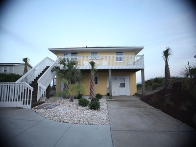 Front of beautiful beach house from road