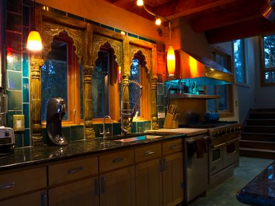 Balinese architectural piece in the kitchen/ viking range w/double ovens&griddle