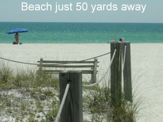 Indian Shores condo photo - Stroll to the beach and put your toes in the sand.