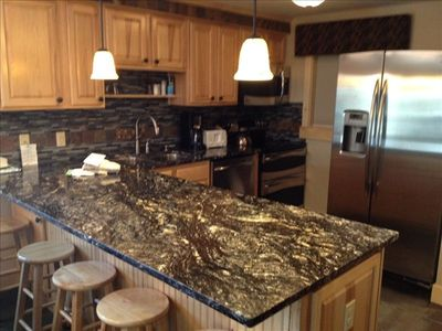Beautiful Kitchen with Granite Counter tops and Stainless Steel Appliances