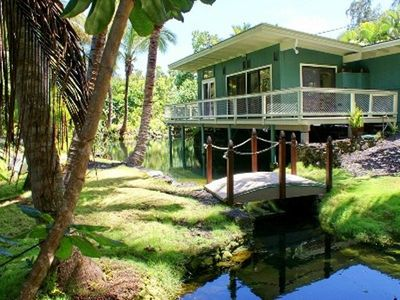 Pahoa cottage rental - Bridge across the large pond looking towards the rear of the cottage