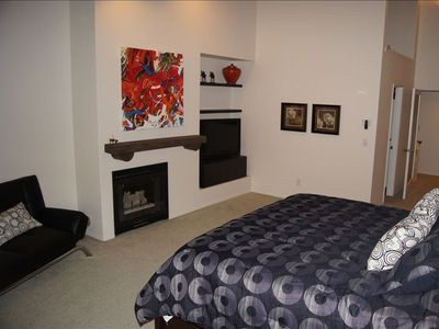 Master Bedroom w/ gas fireplace, LCD TV, huge walk-in closet and master en suite