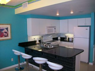 Newly renovated gorgeous granite counter tops in the kitchen. - Daytona Beach condo vacation rental photo