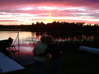 Walker cabin photo - Sunset with dock and boat lift and a great way to end the day.