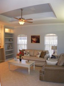 Living room with queen size sleeper sofa, love seat and coffee tables.