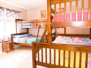 Anaheim house photo - Two sets of bunk beds with theme bed linens and view of the beautiful backyard.