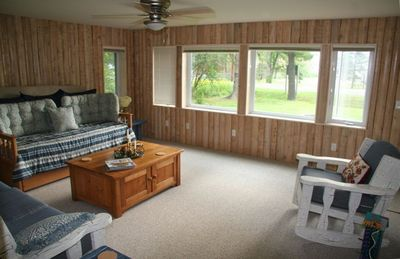 Living Area (twin beds too!) Hand hewn log walls saved from original cabin