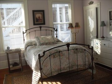 Guest bedroom. Very cozy. Antique iron bed.