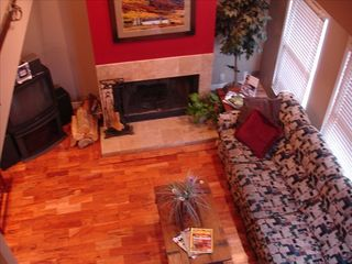 Old Town townhome photo - Living room with fireplace, sectional, and ... now