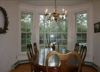 East Orleans house photo - Formal Dining Room looks out the large back yard.