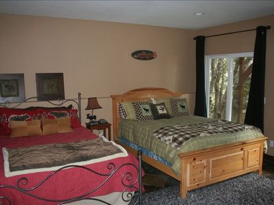 Guest Bedroom (Bottom Floor) with 2 Queen Beds and laundry room