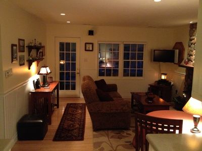 Comfortable living room with flat screen television, DVD / VCR and stereo