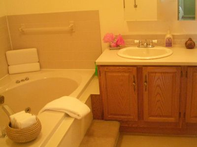 Jetted bath, large vanity; not shown; separate shower small but ample