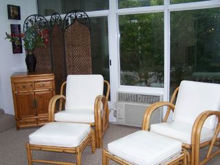 Langley house photo - Sunroom seating overlooking deck and lake