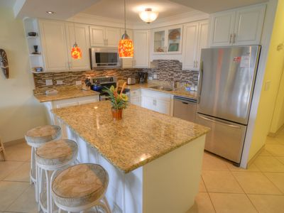 Have a  seat at the island in the spacious kitchen
