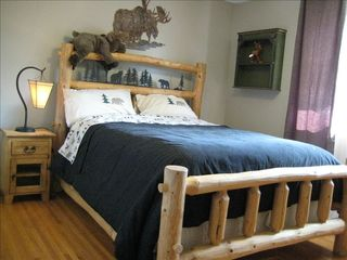 Calgary house photo - Bedroom with a queen size Log bed, nice and cozy!