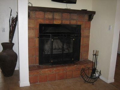 Blueberry Ribbon Cottage wood fireplace with electric circulation fan.