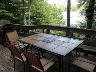 Big Bass Lake house photo - Deck with outdoor dining table