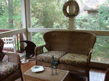 Cozy, comfortable screen porch. Off of kitchen and deck.