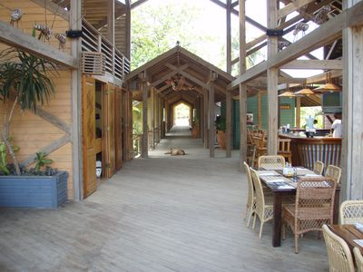 Palmetto main building, reception on left, bar and restaurant seating on right