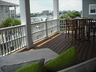 Wrightsville Beach condo photo - Nothing better than a good book, a glass of wine, on the oversized chaise.