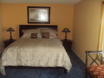 Master bedroom with Cal King bed & attached bath overlooks olive & citrus trees.