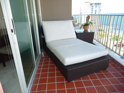 Balcony View with Chaise Chair
