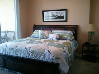 Ocean Reef condo photo - Master bedroom has king size bed, flat screen TV and private access to balcony