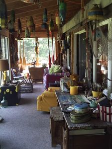 Long view of the porch and our collection of hanging buoys!
