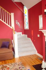 South Haven house photo - Staircase with hand-painted touches and stained glass window