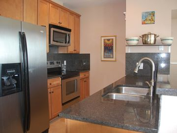 Granite kitchen counters and stainless appliances