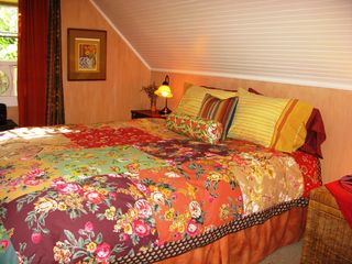 Healdsburg cottage photo - The upstairs bedroom features a queen bed covered in a patchwork of flowers.