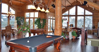 Living room with pool table.