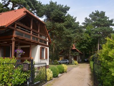 In a very quiet area, 50 meters from the beach, surrounded by pine trees