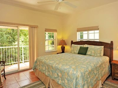 Guest bedroom with King bed and private balcony