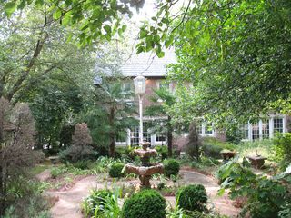 Atlanta house photo - View of lovely English garden and fountain looking toward back of house