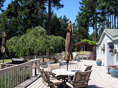 Spacious 1200 sq ft. Deck with Table Seating, BBQ, Umbrellas & Picnic Table.