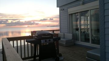 The Cool House's deck with gas grill and sunset view