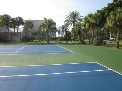 Two beautiful tennis courts resurfaced in 9/2012. Surrounded by palm trees!