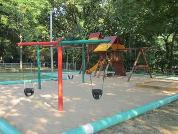 This is the closest playground. A charcoal grill is next to each playground.