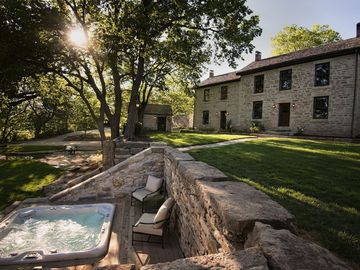 Manhattan estate rental - Native limestone buildings and terraces nestled into the country hillside.