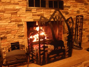 Kitchen Fireplace. Free Pecan,Oak,Aspen,Juniper Firewood stacked next to cabin