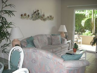 Grand Cayman condo photo - Living room area has comfy seating