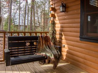 Pigeon Forge cabin photo - enviting porch swing on large covered front porch to watch the wild turkeys feed