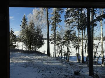 Fresh snowfall from living room looking out onto the lake