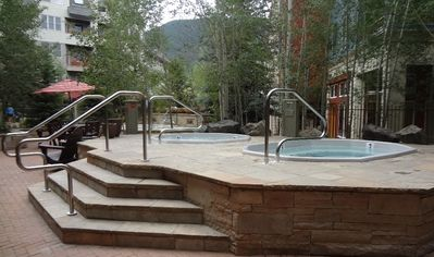 Silver Mill's two 8 person hot tubs next to the large 16 person hot tub.