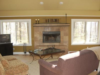 Living Room View of Woods and Fireplace