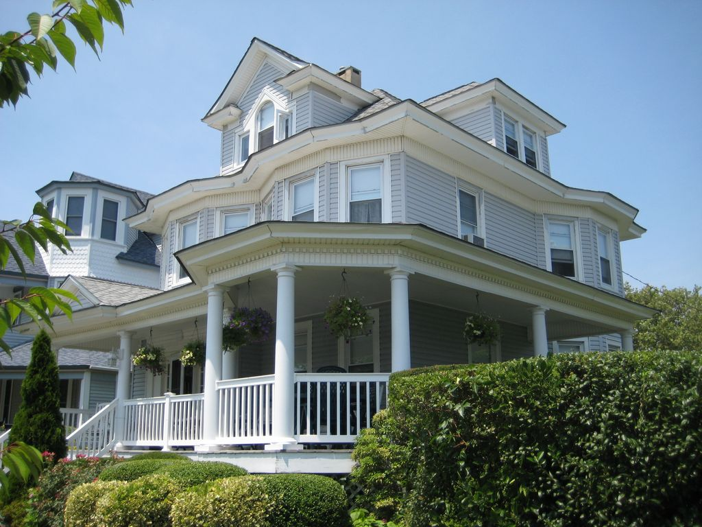 Classic avon shore house half a block from beach vrbo for Beach house with wrap around porch